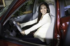 Portrait of a woman taking a test drive Stock Photos