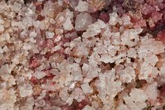 Natural pink coarse salt Stock Photos