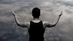 Superhero powerful strong man male. on top. clouds. heaven. hands up Stock Footage