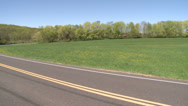 Stock Video Footage of View of open field from road (1 of 4)