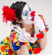 Clown yelling close up portrait bright beautiful female performer Stock Photos
