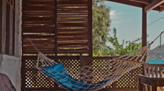 Hammock on the Seaside Patio Time Lapse Stock Footage