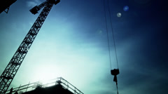 Crane lifts construction materials to iron workers time lapse Stock Footage