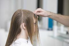 Stock Photo of Woman Getting Haircut At Beauty Salon