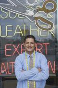 Man standing infront of laundrette shop window Stock Photos