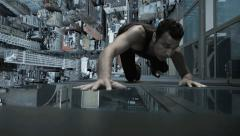 Spider man climbing wall of skyscraper. skyline city background. superhero man Stock Footage