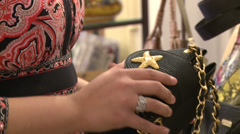 Woman examining pocketbook in antique store (3 of 4) Stock Footage