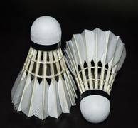 A white shuttlecock isolated on black Stock Photos