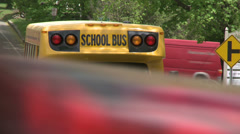 Small school bus traveling on road (2 of 5) Stock Footage