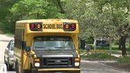 Stock Video Footage of Small school bus traveling on road (3 of 5)