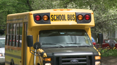 Small school bus traveling on road (4 of 5) Stock Footage