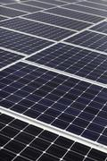 Diagonal line of solar array - stock photo