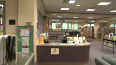 Circulation desk and seating area of Gunn Memorial Library Stock Footage