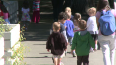 Stock Video Footage of Preschool aged children walking along path (2 of 5)