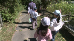 Children running along path to petting zoo (1 of 3) - stock footage
