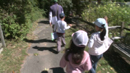Stock Video Footage of Children running along path to petting zoo (1 of 3)