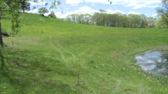 Pond in a hilly meadow (2 of 2) Stock Footage
