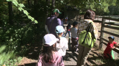 Children running along path to petting zoo (2 of 3) Stock Footage