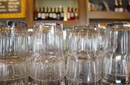 Stock Photo of Upturned glasses at a pub counter