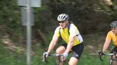 Cyclists riding alongside road (5 of 9) Stock Footage