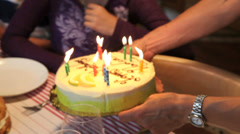 girls blowing out her birthday cake - stock footage