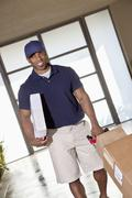 African American man with packages to deliver - stock photo