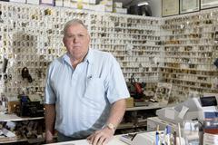 Portrait of locksmith in store - stock photo