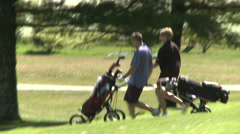 Couple walking with wheeled golf bag (1 of 2) Stock Footage