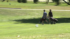 Couple walking with wheeled golf bag (2 of 2) Stock Footage