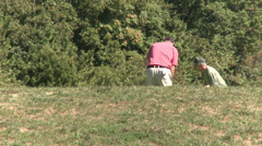 Two golfers practicing swing in the rough Stock Footage