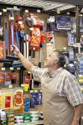 Mature salesperson working in hardware store Stock Photos
