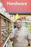 Mature salesperson reading something in hardware store Stock Photos