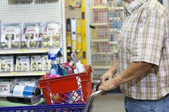 Midsection of man with shopping cart in hardware store Stock Photos