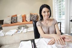 Beautiful happy woman getting herself pampered in beauty spa - stock photo