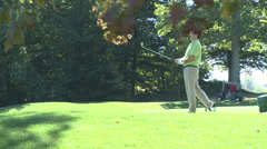 Golfer takes a practice swing near tee (1 of 2) Stock Footage