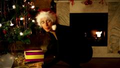 Pretty female santa brings a lot of presents Stock Footage