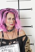 Mug shot of senior punk woman - stock photo