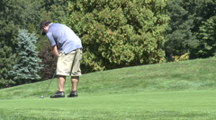 Lefty golfer putts ball (1 of 2) Stock Footage