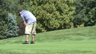 Stock Video Footage of Lefty golfer putts ball (1 of 2)