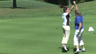 Stock Video Footage of Female golfer putts ball and is excited (2 of 2)