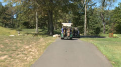 Following golf carts along path (2 of 4) Stock Footage