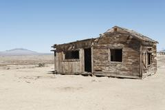Timber home on arid landscape - stock photo