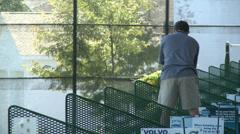 Man practicing swing at driving range Stock Footage