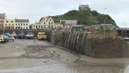 Stock Video Footage of  ilfracombe harbour at low with st nicholas chapel on the hill in ba