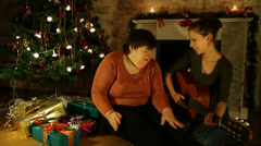 Two women singing  carols Stock Footage