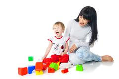 Stock Photo of mother and baby playing with building blocks toy