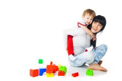Mother and baby playing with building blocks toy Stock Photos
