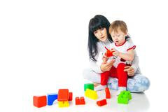 mother and baby playing with building blocks toy - stock photo