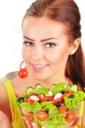 Young woman eating vegetable salad Stock Photos