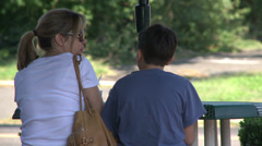 Mother and son enjoying ice cream at outdoor cafe Stock Footage